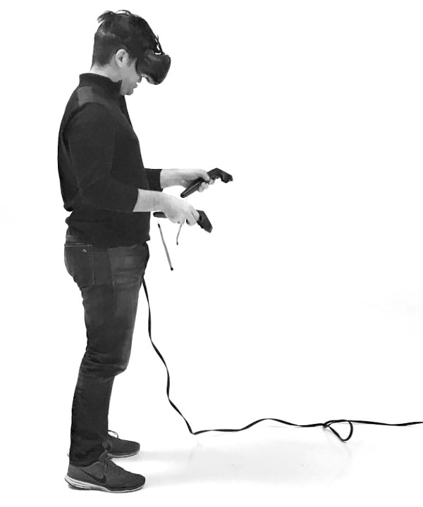 Person using virtual reality headset and controls